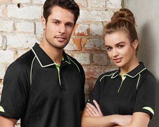 Man and woman wearing blackpolo shirts